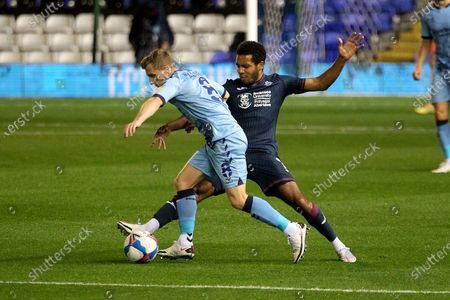 Stock Photo of Coventry City's Jamie Allen Swansea City's Korey Smith during the EFL Sky Bet Championship match between Coventry City and Swansea City at the Trillion Trophy Stadium, Birmingham