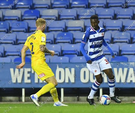 Stock Photo of Reading's Omar Richards takes on Wycombe Wanderers' David Wheelerduring the EFL Sky Bet Championship match between Reading and Wycombe Wanderers at the Madejski Stadium, Reading