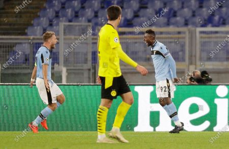 Lazio's Jean-Daniel Akpa Akpro, right, celebrates with his teammate Ciro Immobile after scoring his side's third goal during the Champions League group F soccer match between Lazio and Borussia Dortmund at the Olympic stadium in Rome