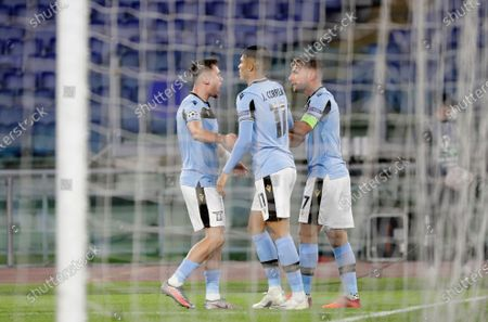 Lazio's Ciro Immobile, right, celebrates with his teammates after scoring his side's opening goal during the Champions League group F soccer match between Lazio and Borussia Dortmund at the Olympic stadium in Rome