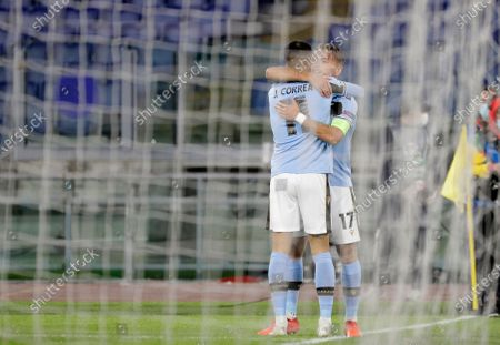 Lazio's Ciro Immobile, right, celebrates with his teammate Joaquin Correa after scoring his side's opening goal during the Champions League group F soccer match between Lazio and Borussia Dortmund at the Olympic stadium in Rome