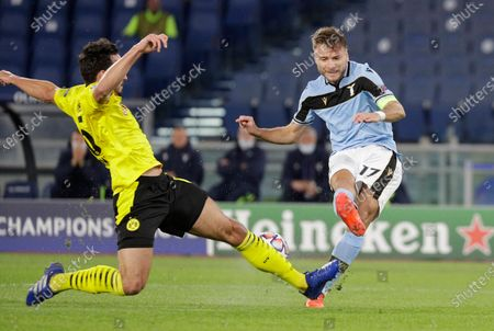 Dortmund's Thomas Delaney, left, challenges for the ball with Lazio's Ciro Immobile during the Champions League group F soccer match between Lazio and Borussia Dortmund at the Olympic stadium in Rome