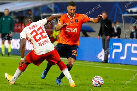 Basaksehir's Aziz Behich, right tries to get past Leipzig's Nordi Mukiele during a Group H Champions League soccer match between RB Leipzig and Istanbul Basaksehir at the RB Arena in Leipzig, Germany