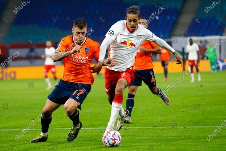 Basaksehir's Martin Skrtel, left challenges for the ball with Leipzig's Yussuf Poulsen during a Group H Champions League soccer match between RB Leipzig and Istanbul Basaksehir at the RB Arena in Leipzig, Germany