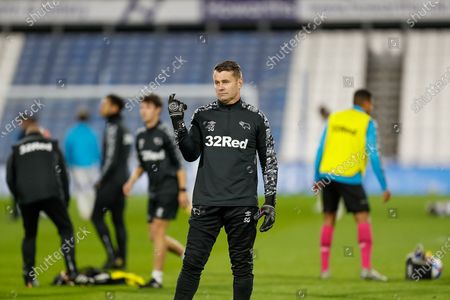 Derby County FC Goalkeeper Coach Shay Given warming up before the EFL Sky Bet Championship match between Huddersfield Town and Derby County at the John Smiths Stadium, Huddersfield
