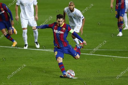 Barcelona's Lionel Messi scores a penalty during the Champions League group G soccer match between FC Barcelona and Ferencvaros at the Camp Nou stadium in Barcelona, Spain