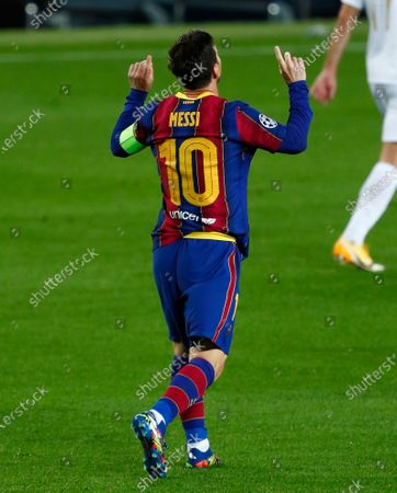 Stock Photo of Barcelona's Lionel Messi celebrates after scoring the opening goal of his team during the Champions League group G soccer match between FC Barcelona and Ferencvaros at the Camp Nou stadium in Barcelona, Spain