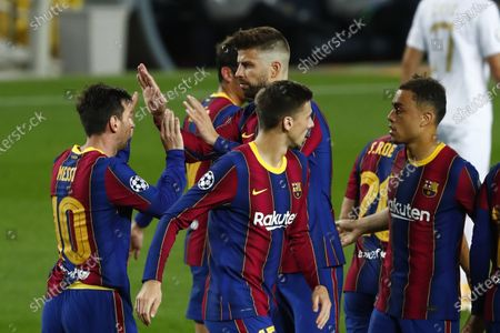 Barcelona players celebrate the opening goal of their team during the Champions League group G soccer match between FC Barcelona and Ferencvaros at the Camp Nou stadium in Barcelona, Spain