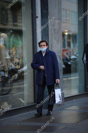 Stock Photo of Urbano Cairo buys shoes
