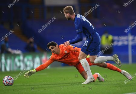 Chelsea's Timo Werner, right, tries unsuccesfully to dribble past Sevilla's goalkeeper Yassine Bounou, during the Champions League Group E soccer match between Chelsea and Sevilla at Stamford Bridge, London, England