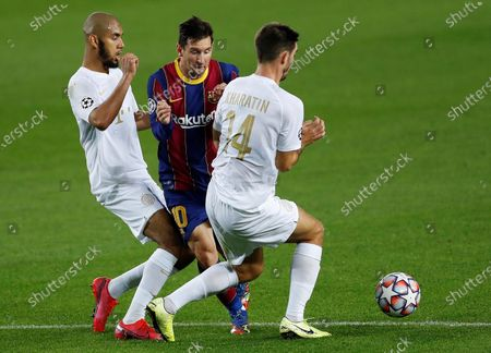 Stock Picture of FC Barcelona's Lionel Messi (C) in action against Ferencvaros' midfielders Aissa Laidouni (L) and Ihor Kharatin (R) during the UEFA Champions League Group G soccer match between FC Barcelona and Ferencvaros held at Camp Nou stadium, in Barcelona, Spain, 20 October 2020.