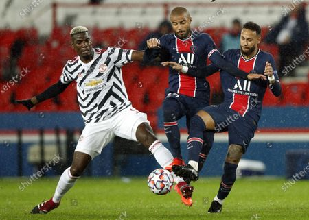(L-R) Manchester United's Paul Pogba, Paris Saint Germain's Rafinha and Paris Saint Germain's Neymar Jr in action during the UEFA Champions League Group H soccer match between PSG and Manchester United at the Parc des Princes stadium in Paris, France, 20 October 2020.