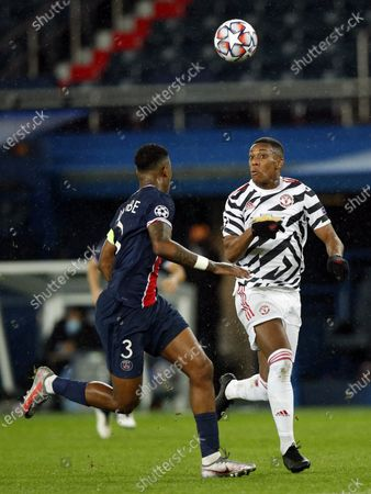 Paris Saint Germain's Presnel Kimpembe (L) and Manchester United's Anthony Martial in action during the UEFA Champions League Group H soccer match between PSG and Manchester United at the Parc des Princes stadium in Paris, France, 20 October 2020.
