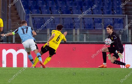 Lazio's Ciro Immobile (L) scores the 1-0 goal during the UEFA Champions League  Group F soccer match between SS Lazio and Borussia Dortmund, at Stadio Olimpico in Rome, Italy, 20 October 2020.