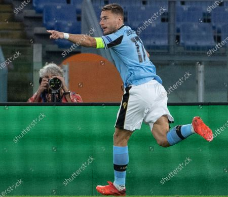 Stock Picture of Lazio's Ciro Immobile celebrates after scoring the 1-0 goal during the UEFA Champions League  Group F soccer match between SS Lazio and Borussia Dortmund, at Stadio Olimpico in Rome, Italy, 20 October 2020.