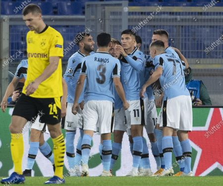 Lazio's Ciro Immobile (C) celebrates with teammates after scoring the 1-0 goal during the UEFA Champions League  Group F soccer match between SS Lazio and Borussia Dortmund, at Stadio Olimpico in Rome, Italy, 20 October 2020.