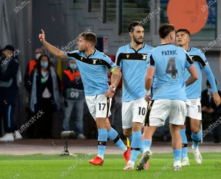 Stock Photo of Lazio's Ciro Immobile (L) celebrates with teammates after scoring the 1-0 goal during the UEFA Champions League  Group F soccer match between SS Lazio and Borussia Dortmund, at Stadio Olimpico in Rome, Italy, 20 October 2020.