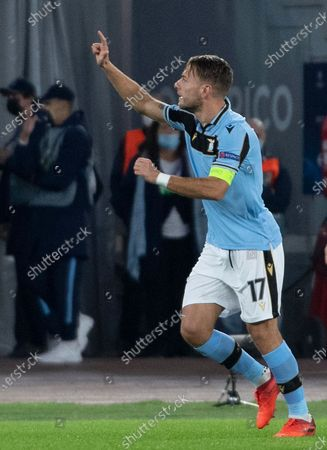 Lazio's Ciro Immobile celebrates after scoring the 1-0 goal during the UEFA Champions League  Group F soccer match between SS Lazio and Borussia Dortmund, at Stadio Olimpico in Rome, Italy, 20 October 2020.