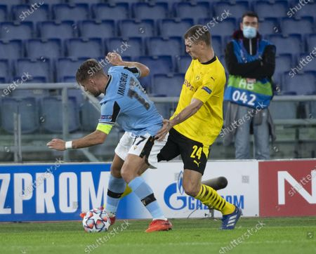 Lazio's Ciro Immobile (L) fights for the ball with Thomas Meunier of Borussia Dortmund during the UEFA Champions League Group F soccer match between SS Lazio and Borussia Dortmund, at Stadio Olimpico in Rome, Italy, 20 October 2020.