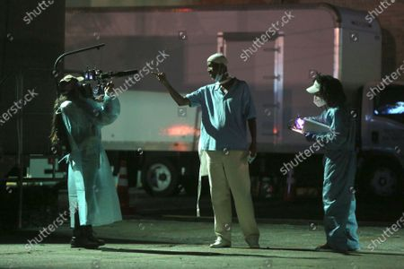 Basim Abdel-Aziz, center, rehearses with colleagues for 5711 Avalon, a Slauson Rec. Theater Company play that explores a drive through COVID-19 testing site in South Los Angeles on Thursday, Oct. 1, 2020 in Los Angeles, CA. (Dania Maxwell / Los Angeles Times)