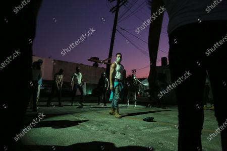 Stock Picture of Actors warm up for 5711 Avalon, a Slauson Rec. Theater Company play that explores a drive through COVID-19 testing site in South Los Angeles on Thursday, Oct. 1, 2020 in Los Angeles, CA. (Dania Maxwell / Los Angeles Times)