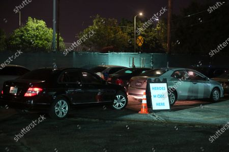 Stock Photo of A line of cars wait their cue for a dress rehearsal for 5711 Avalon, a Slauson Rec. Theater Company play that explores a drive through COVID-19 testing site in South Los Angeles on Thursday, Oct. 1, 2020 in Los Angeles, CA. (Dania Maxwell / Los Angeles Times)