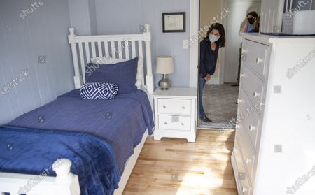 Democratic candidate for United States Senate Sara Gideon looks in on a bedroom as she tours the Crossroads treatment center, during a campaign stop in Portland, Maine, USA, 20 October 2020. Gideon is challenging incumbent Republican Senator Susan Collins of Maine in the upcoming election on 03 November 2020.