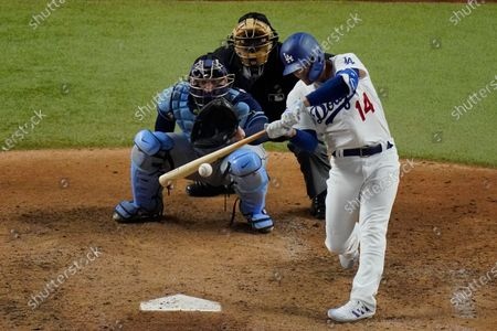 Los Angeles Dodgers' Enrique Hernandez hits a RBI-single against the Tampa Bay Rays during the fifth inning in Game 1 of the baseball World Series, in Arlington, Texas