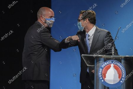 Sept. 29, 2020, shows Utah Lt. Gov. Spencer Cox, left, a Republican and Democratic challenger Chris Peterson, rivals to become Utah's next governor, bumping elbows after facing each other in a prime-time debate in Salt Lake City. Rival candidates vying to become Utah's next governor joined together in new ads, urging people to accept the results of the November elections and maintain decency with one another despite political differences