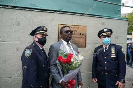 Assistant Chief and Executive Officer Transit Bureau Vincent Coogan, father of Randolph Holder, Chief of Transit Bureau Edward Delatorre attend bridge name dedication and plaque installation in memory of his son in Harlem. Pedestrian footbridge over Franklin D. Roosevelt Drive at 120th Street where officer Holder was killed in 2015 connects Harlem streets and public bike and walkway along Harlem river. Randolph Holder was posthumously promoted from the rank of officer to the rank of Detective. Detective Randolph Holder was shot and killed while pursuing an armed male subject.