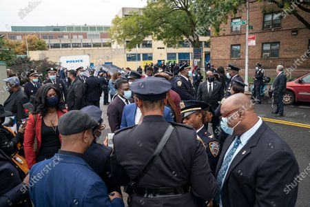 Family members and police officers attend bridge name dedication and plaque installation in memory of Randolph Holder in Harlem. Pedestrian footbridge over Franklin D. Roosevelt Drive at 120th Street where officer Holder was killed in 2015 connects Harlem streets and public bike and walkway along Harlem river. Randolph Holder was posthumously promoted from the rank of officer to the rank of Detective. Detective Randolph Holder was shot and killed while pursuing an armed male subject.