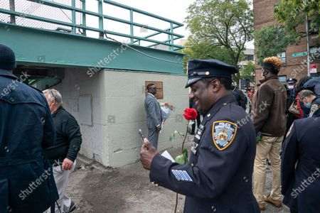 Father of Randolph Holder attends bridge name dedication and plaque installation in memory of his son in Harlem. Pedestrian footbridge over Franklin D. Roosevelt Drive at 120th Street where officer Holder was killed in 2015 connects Harlem streets and public bike and walkway along Harlem river. Randolph Holder was posthumously promoted from the rank of officer to the rank of Detective. Detective Randolph Holder was shot and killed while pursuing an armed male subject.