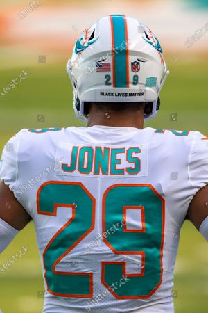 Miami Dolphins safety Brandon Jones (29) wears a Black Lives Matter sticker on his helmet on the field before the Dolphins take on the New York Jets during an NFL football game, in Miami Gardens, Fla