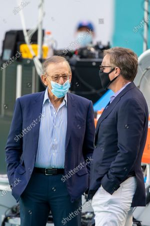 Miami Dolphins Chairman of the Board/Managing General Partner Stephen Ross and Miami Dolphins Vice Chairman, President and Chief Executive Officer Tom Garfinkel (right) wear a masks as they speak on the sidelines before the Dolphins take on the New York Jets during an NFL football game, in Miami Gardens, Fla