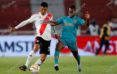 Stock Picture of Enzo Perez of Argentina's River Plate, left, and Jhojan Julio of Ecuador's Liga Deportiva Universitaria battle for the ball during a Copa Libertadores soccer match in Buenos Aires, Argentina