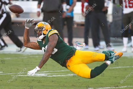 Green Bay Packers tight end Marcedes Lewis (89) reaches for a pass against the Tampa Bay Buccaneers during an NFL football game, in Tampa, Fla