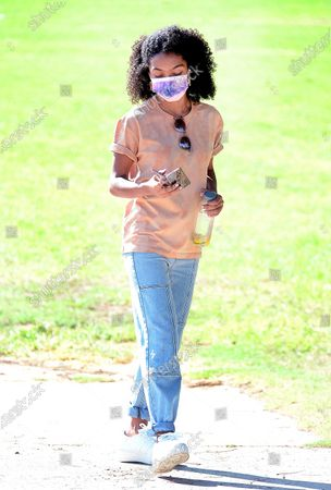 Stock Image of Yara Shahidi steps out wearing a PacSun shirt and denim while enjoying a day in the park with her brother Sayeed in Pasadena