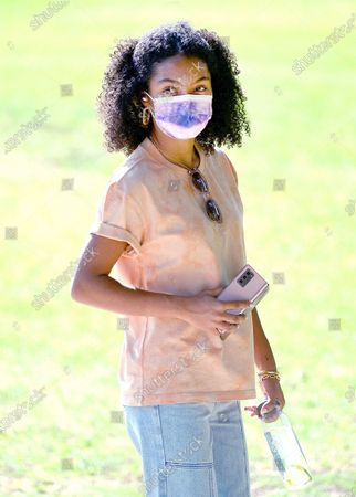 Yara Shahidi steps out wearing a PacSun shirt and denim while enjoying a day in the park with her brother Sayeed in Pasadena
