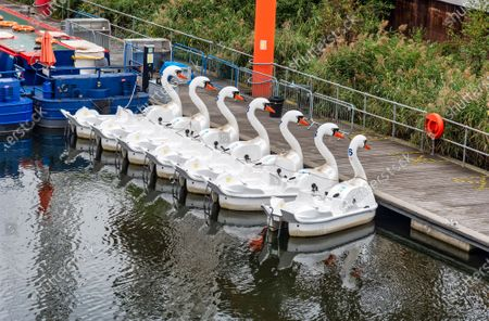 Stock Picture of Swan Pedalos remain tied up at the Queen Elizabeth Olympic Park, despite the government advice to have them open for some household groups.