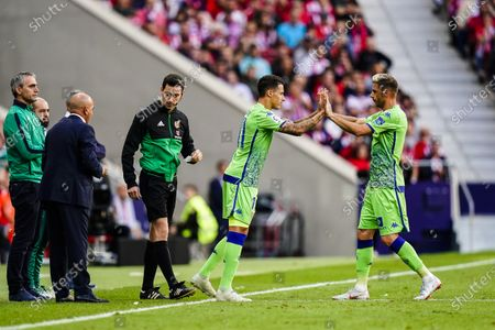 Joaquin Rodriguez of Real Betis (R) is switched by Cristian Herrera of Real Betis (L) during the La Liga 2018-19 match between Atletico de Madrid and Real Betis at Wanda Metropolitano Stadium