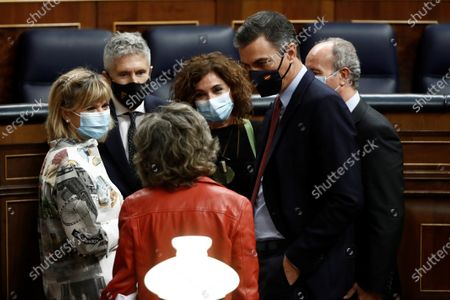 Spanish Prime Minister, Pedro Sanchez (2R), chats with MPs Maria Luisa Carcedo (C, front( and Susana Ros (L) next to his ministers Fernando Grande Marlasca (2-L), Maria Jesus Montero (3R) and Juan Carlos Campo (R) during a break of the debate of a non-confidence vote against PM Pedro Sanchez's government, issued by far-right Vox party, at Congress of Deputies in Madrid, Spain, 21 October 2020. Any party has supported Vox in its challenge to get the passing of the motion.