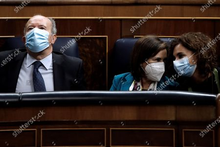 Spanish Justice Minister Juan Carlos Campo (L), Defense Minister Margarita Robles (C) and Treasure Minister Maria Jesus Montero attend the debate on a non-confidence vote by far-right party Vox at Congress of Deputies in Madrid, Spain, 21 October 2020. Vox party brought a no-confidence vote motion against the ruling leftist coalition, due to allegations of mismanagement in regards to the government's handling of COVID-19 pandemic.