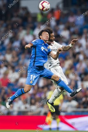 Gaku Shibasaki (L) of Getafe CF battles for the ball with Marcelo Vieira Da Silva of Real Madrid during the La Liga 2018-19 match between Real Madrid and Getafe CF at Estadio Santiago Bernabeu