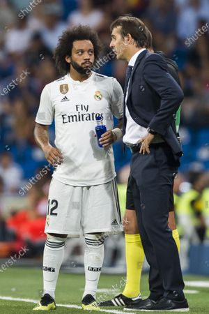 Manager Julen Lopetegui of Real Madrid speaks to Marcelo Vieira Da Silva during the La Liga 2018-19 match between Real Madrid and Getafe CF at Estadio Santiago Bernabeu