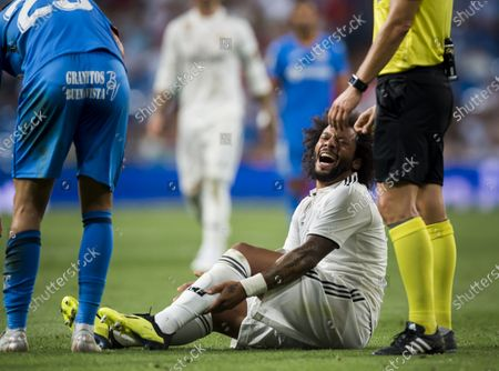 Marcelo Vieira Da Silva of Real Madrid sits on the field in pain during the La Liga 2018-19 match between Real Madrid and Getafe CF at Estadio Santiago Bernabeu