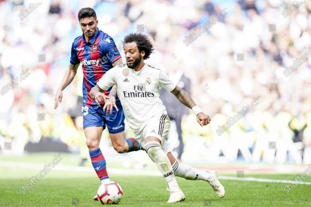 Marcelo Vieira Da Silva of Real Madrid (R) fights for the ball with David Remeseiro Salgueiro, Jason, of Levante UD (L) during the La Liga 2018-19 match between Real Madrid and Levante UD at Estadio Santiago Bernabeu