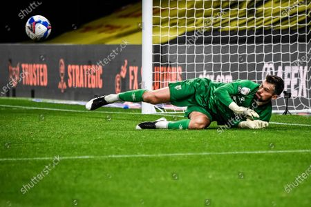 Stock Image of Ben Foster saves a penalty taken by Blackburns Adam Armstrong.; Vicarage Road, Watford, Hertfordshire, England; English Football League Championship Football, Watford versus Blackburn Rovers.