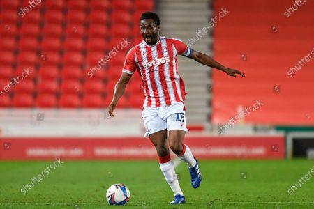John Obi Mikel (13) of Stoke City runs forward with the ball