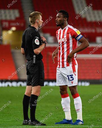John Obi Mikel (13) of Stoke City disagrees with referee Michael Salisbury's decision to show a red card to Nathan Collins (37) of Stoke City