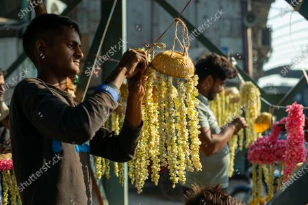 Editorial image of Daily life in flower market, New Delhi, India - 21 Oct 2020